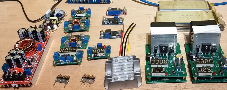 I've played with a lot of power modules, all but two of these fail! The units on the right are inexpensive DC electronic loads that simulate the draw from your device in a way you can measure the power sources voltage drop, current and noise.